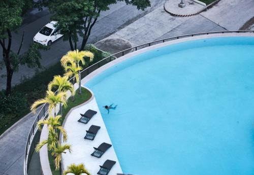 A view of the pool at Limketkai Luxe Hotel or nearby