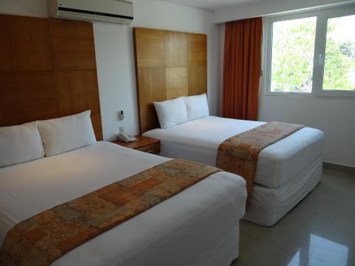 Cama o camas de una habitación en Hotel Suites Gaby