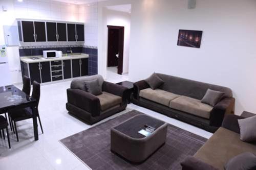 Uma área de estar em Talah Aparthotel