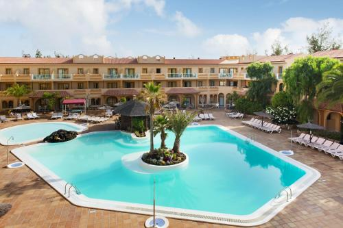 The swimming pool at or near Elba Lucía Sport & Suite Hotel