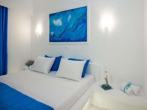 Säng eller sängar i ett rum på Mojito Beach Rooms