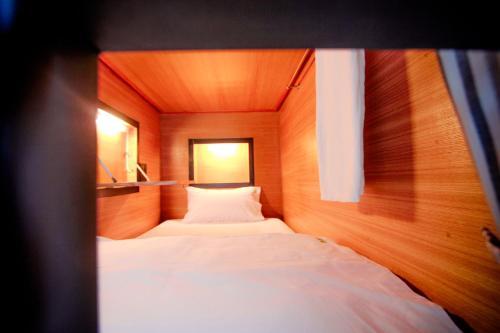 Ein Bett oder Betten in einem Zimmer der Unterkunft Hug Bed And Breakfast