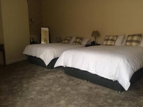 Кровать или кровати в номере The Black Bull