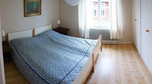 Säng eller sängar i ett rum på Villa Arboretum