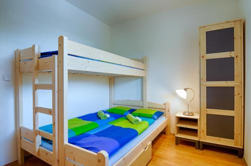A bunk bed or bunk beds in a room at Apartment Marketa