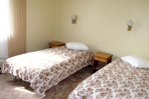 A bed or beds in a room at Meteorits