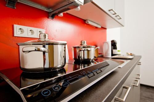 A kitchen or kitchenette at Design Sleepy Cologne