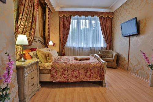 Кровать или кровати в номере Lakshmi Apartment Boulevard 3-Bedroom