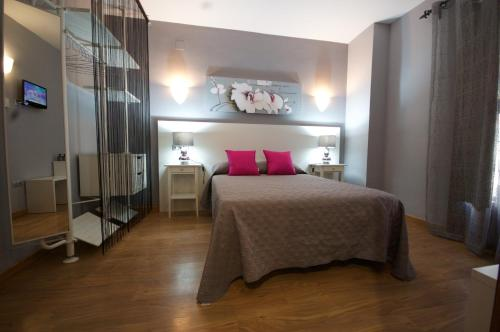 Cama o camas de una habitación en Hotel Hc Zoom