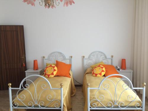 A bed or beds in a room at B&B Soleluna