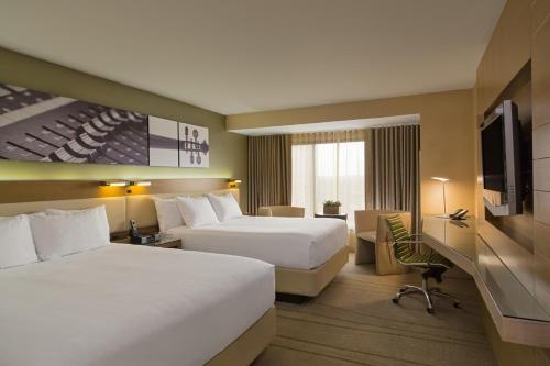 A bed or beds in a room at Hyatt Regency Austin