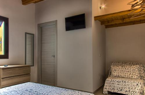 TV o dispositivi per l'intrattenimento presso Casa Vacanze Andolina Suite