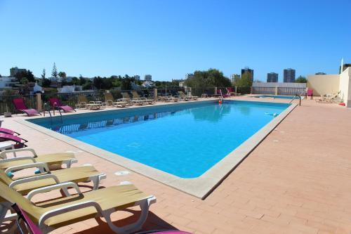 The swimming pool at or near Buganvília Holidays