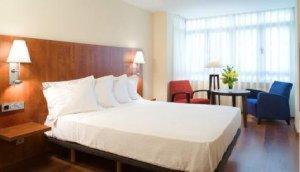 Cama o camas de una habitación en Hotel Arena