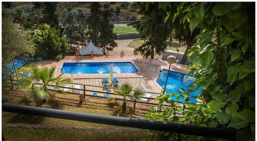 A view of the pool at Hotel Abetos del Maestre Escuela or nearby