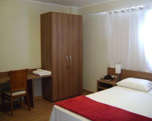 Cama ou camas em um quarto em Hotel Areias Brancas