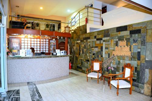 The lobby or reception area at Panorama Hotel Apartments