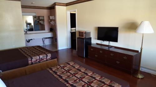 A television and/or entertainment center at Anaheim Astoria Inn & Suites