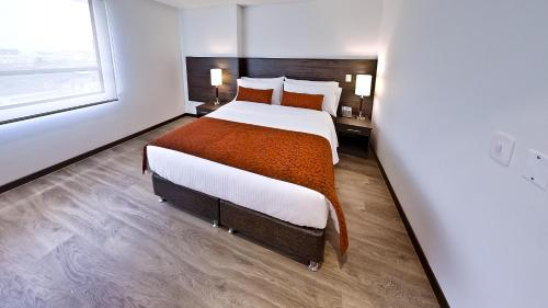 A bed or beds in a room at AZ Hotel