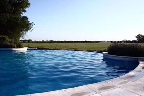The swimming pool at or near Estancia El Ombu De Areco