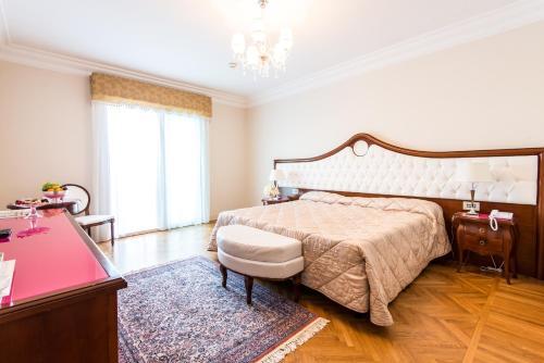 Grand Hotel Italiaにあるベッド