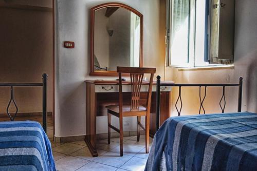 Letto o letti in una camera di B&B Sogni Goti