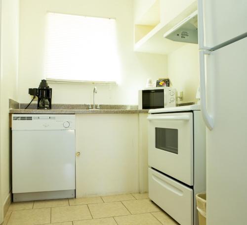A kitchen or kitchenette at Sands Inn & Suites