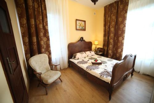Łóżko lub łóżka w pokoju w obiekcie Willa Podzamcze