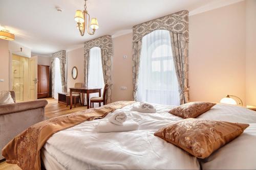 Łóżko lub łóżka w pokoju w obiekcie Leśna Polana
