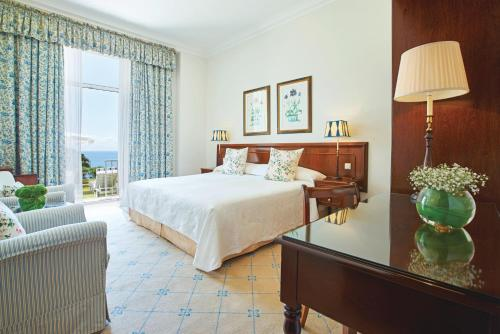 A bed or beds in a room at Reid's Palace, A Belmond Hotel, Madeira