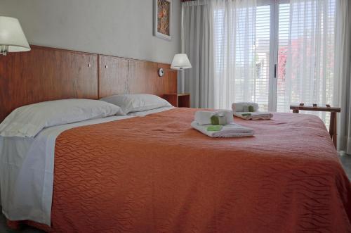 Кровать или кровати в номере Nuna Ayni Apartments