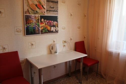 Кухня или мини-кухня в Malaya Samara Apartment