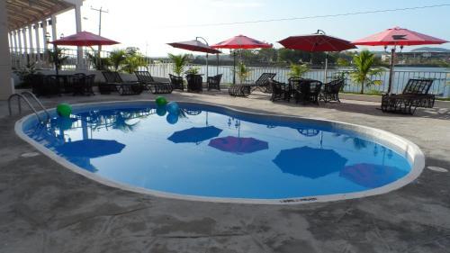The swimming pool at or near Ramada by Wyndham Tikal Isla de Flores