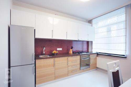 A kitchen or kitchenette at Familion ApartHotel