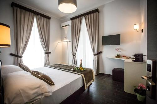 A bed or beds in a room at San Pietro Leisure and Luxury