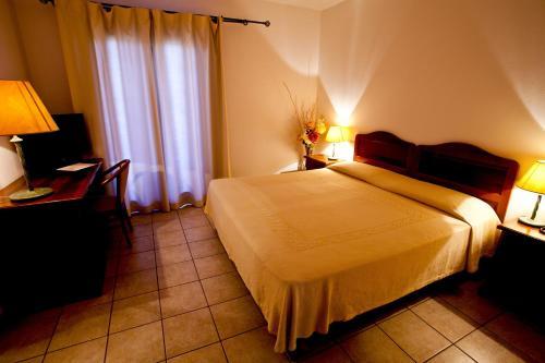 Cama ou camas em um quarto em Hotel Moderno