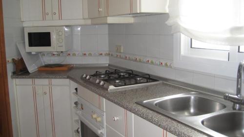 Ett kök eller pentry på Beach Apartment Minerva