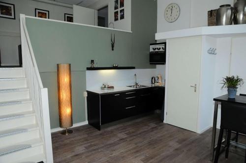 Een keuken of kitchenette bij Gastenappartement De Bergpoort