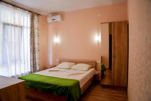 Кровать или кровати в номере Гостевой дом Бухта №5