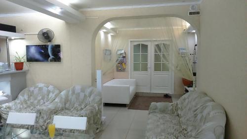 Гостиная зона в Гостиница Полет