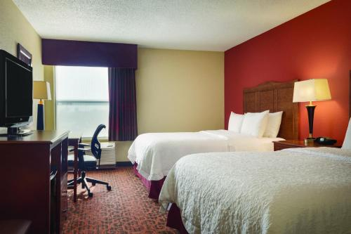 A bed or beds in a room at Hampton Inn Shawnee