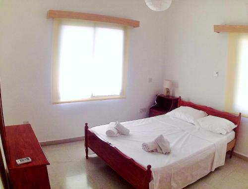 Кровать или кровати в номере Miris Mediterraneo Apartments