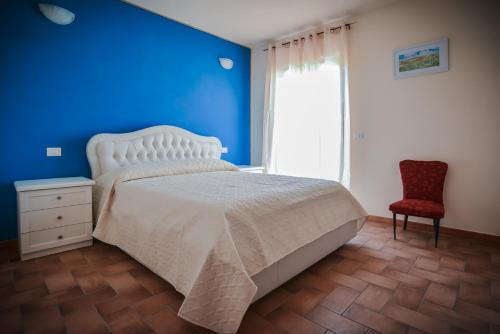 A bed or beds in a room at Agriturismo Airone