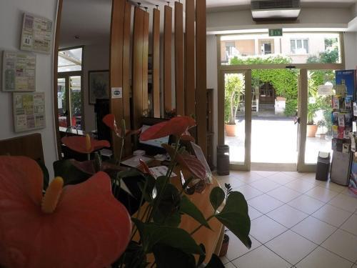 The lobby or reception area at Hotel Ausonia