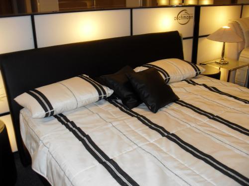 Ein Bett oder Betten in einem Zimmer der Unterkunft Villa Bodenseeblick