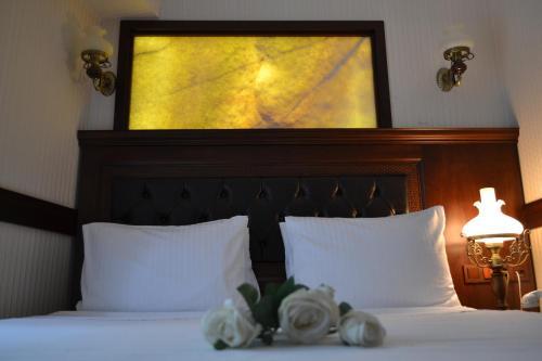 Ein Bett oder Betten in einem Zimmer der Unterkunft Divalis Hotel