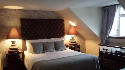 A bed or beds in a room at The Tobermory Hotel