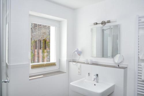 Ein Badezimmer in der Unterkunft Rieslinghaus Bernkastel (ehm.Weinhaus Porn)
