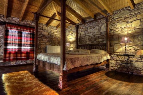 Ένα ή περισσότερα κρεβάτια σε δωμάτιο στο Πέτρινα