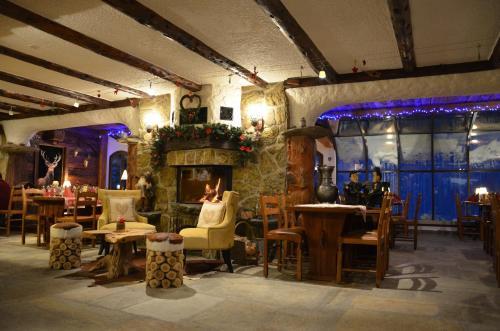 Restaurant ou autre lieu de restauration dans l'établissement Hotel La Cambuse